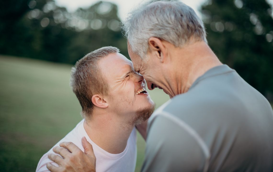 A father hugs his son, who has Down's syndrome.