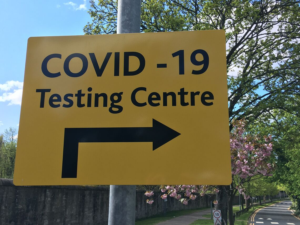"A sign that reads ""COVID-19 Testing Centre"""