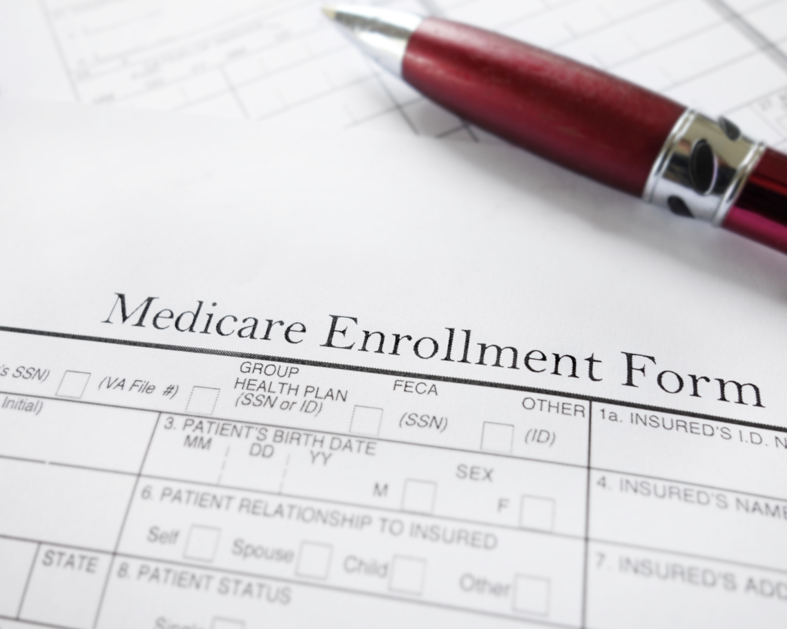 A Medicare enrollment form sits on a table.