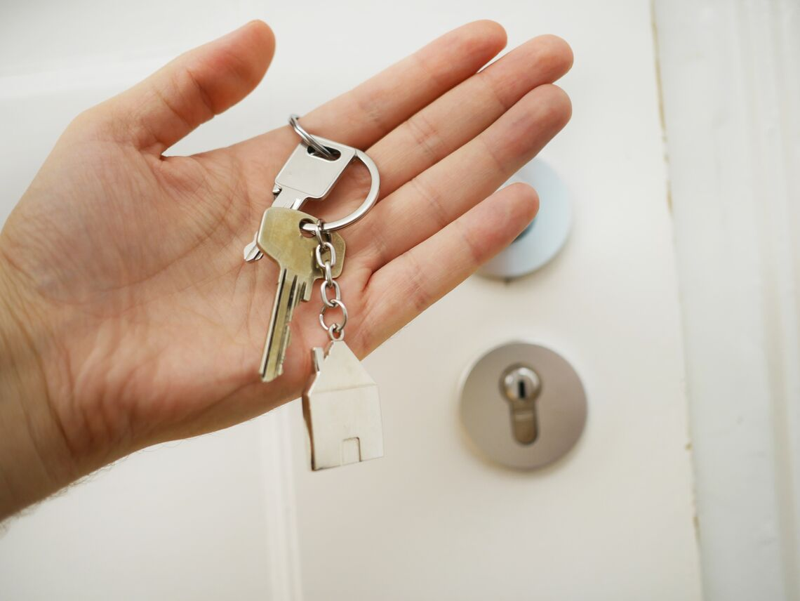 A person holds the keys to their home