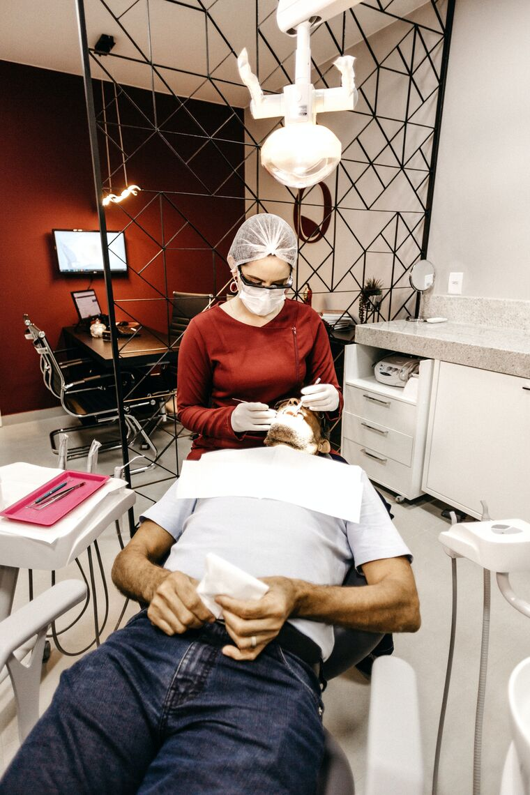 A man is treated in a dentist's office.