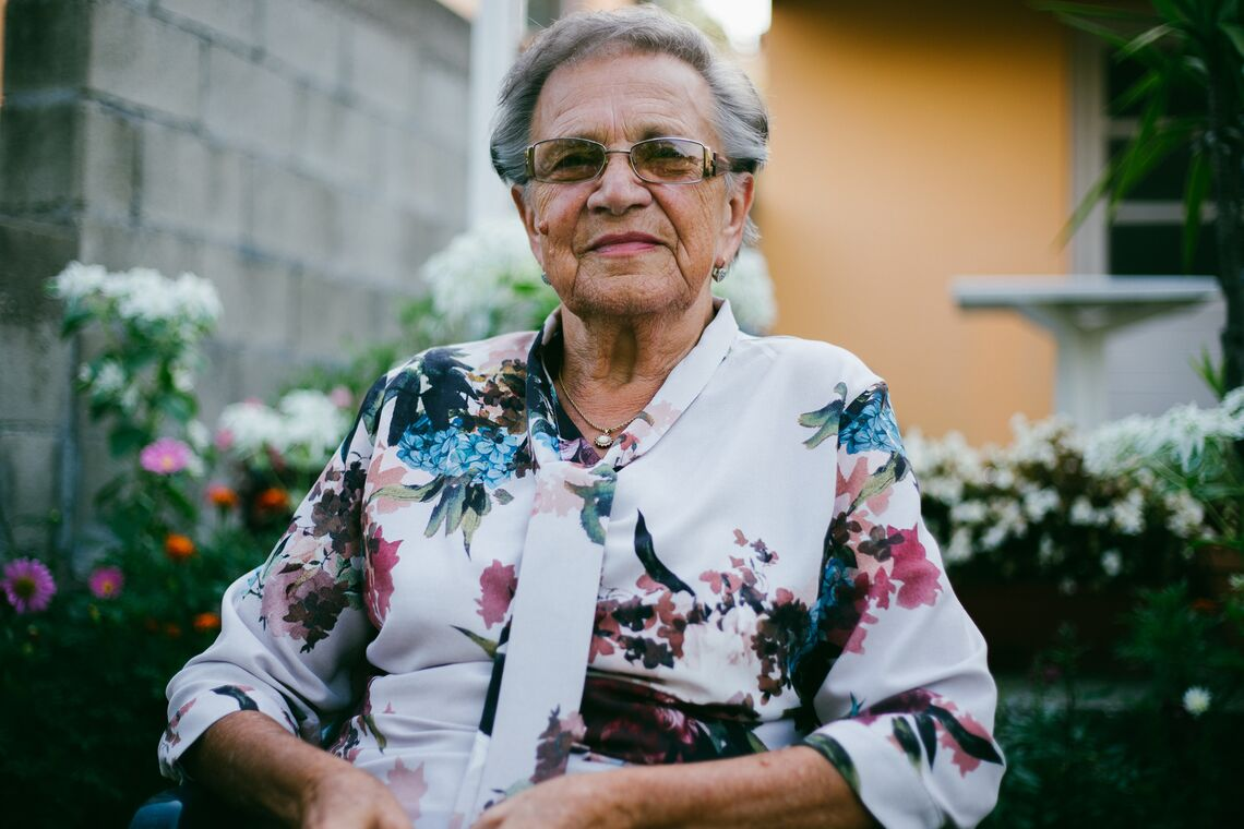 Portrait of an elderly lady, who looks directly into the camera