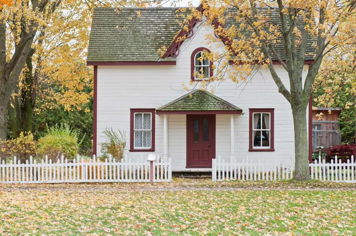 A red and white house in fall